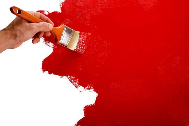 絵画の壁を赤色にペイントブラシ ストックフォト