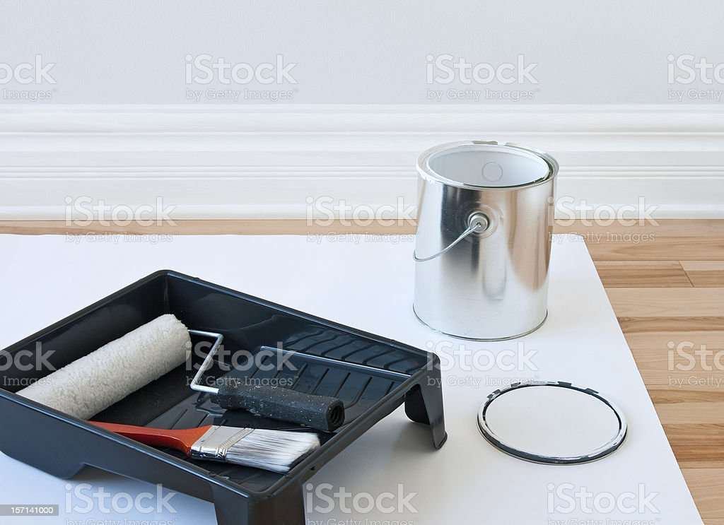 Painting tools and can of paint stock photo