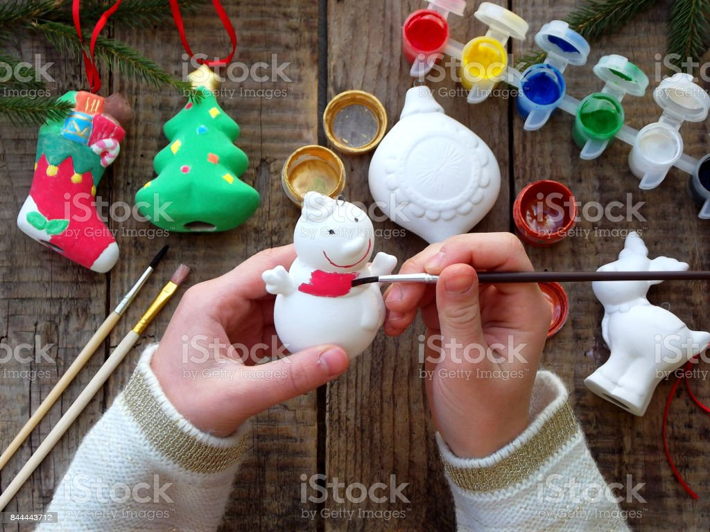 Painting toys for Christmas decorations from porcelain with your own hands. Children's DIY concept. Making xmas tree decoration stock photo