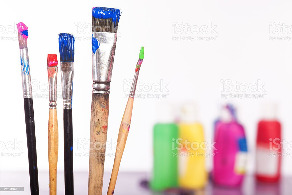 Painting Utensils  in front of colored Pallet stock photo