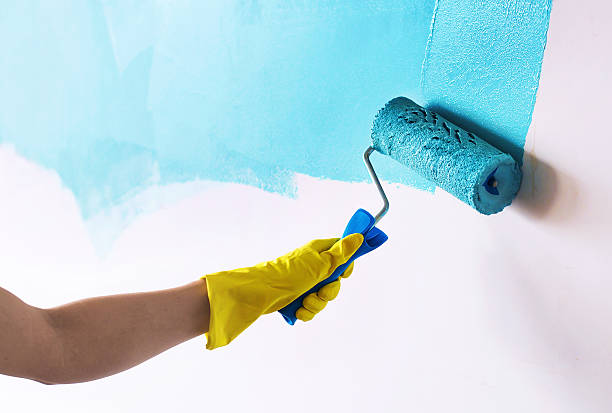 Painting wall in cyan blue color stock photo