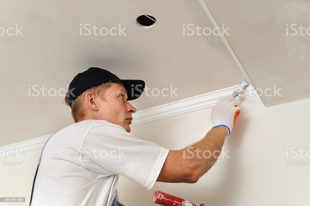 Painting walls and ceilings stock photo