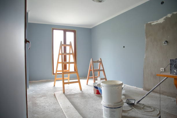 Painting walls of an empty room stock photo