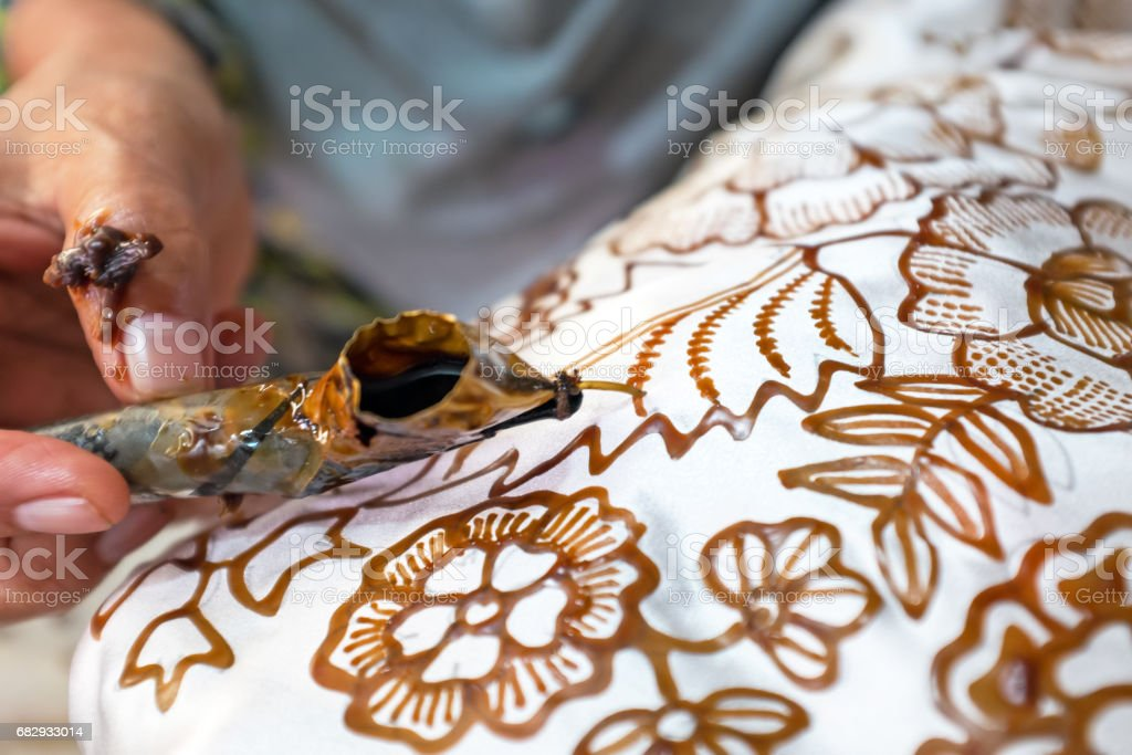 Painting watercolor on the fabric to make Batik Batik-making is part of Indonesian culture stock photo