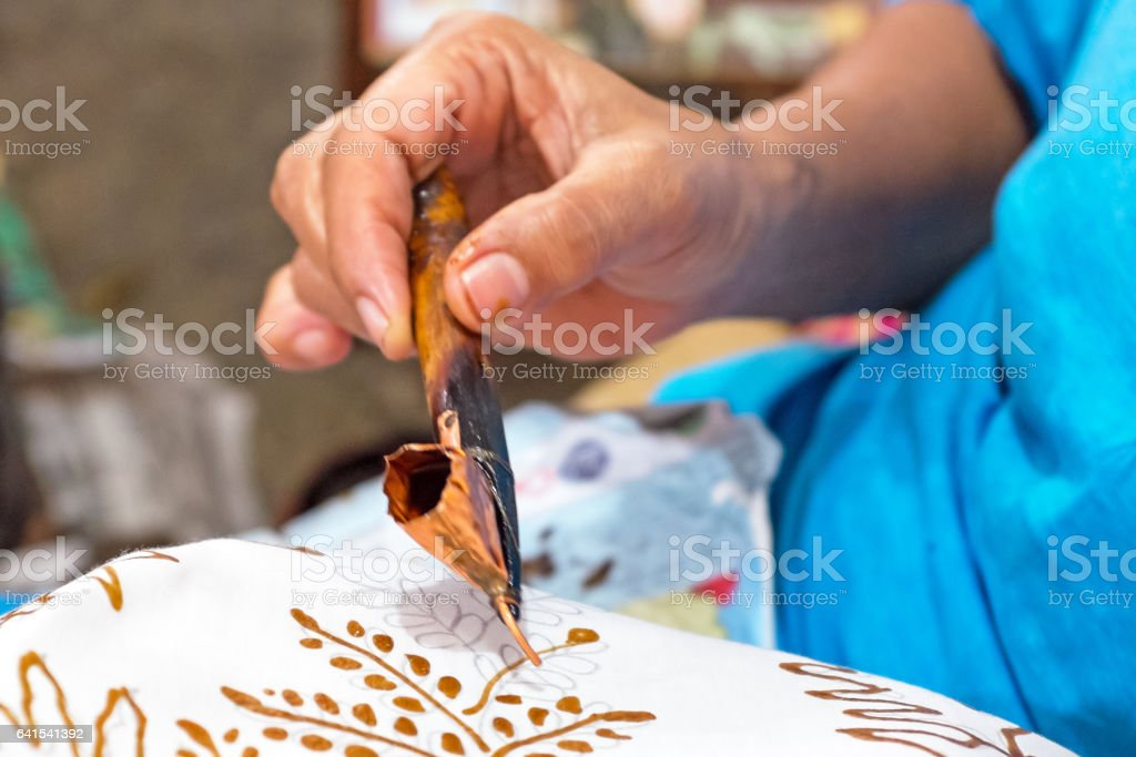 Painting watercolor on the fabric to make Batik. stock photo