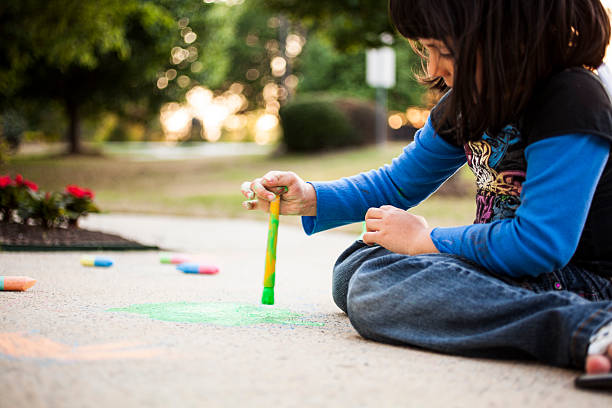painting with chalk on the sidewalk stock photo