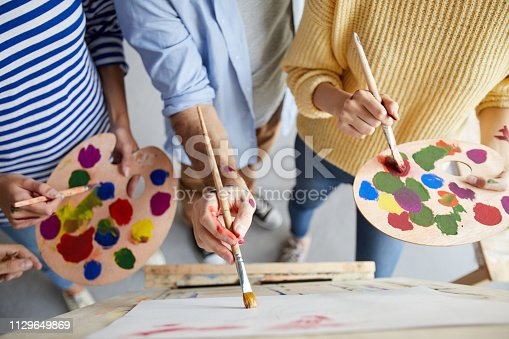 824254912 istock photo Painting with colors 1129649869