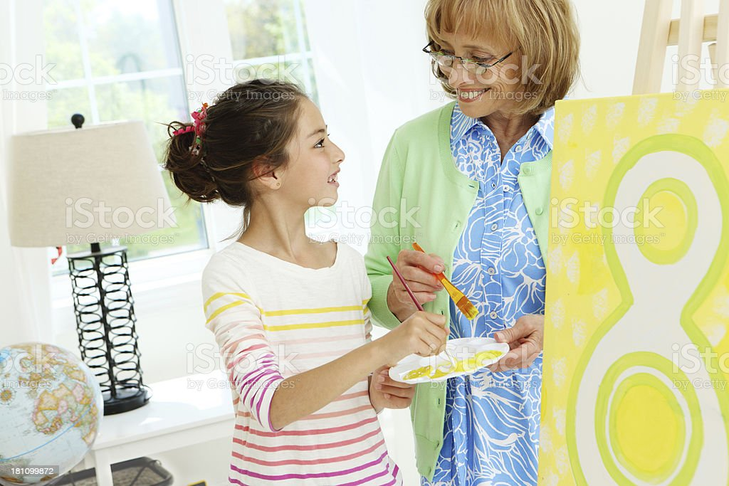 Painting with grandmom royalty-free stock photo