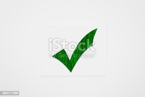 istock Painting with green checkmark on white wall. 683212386