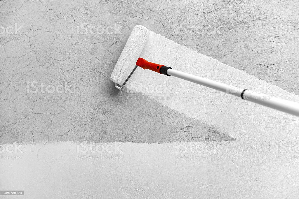 Painting With White Paint by Roller stock photo