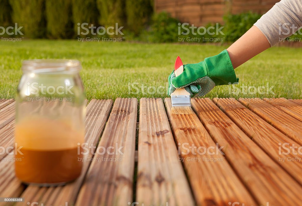 Painting wooden patio deck stock photo