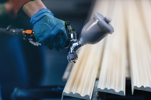 istock Painting wooden slats from an automatic spray 1073146972