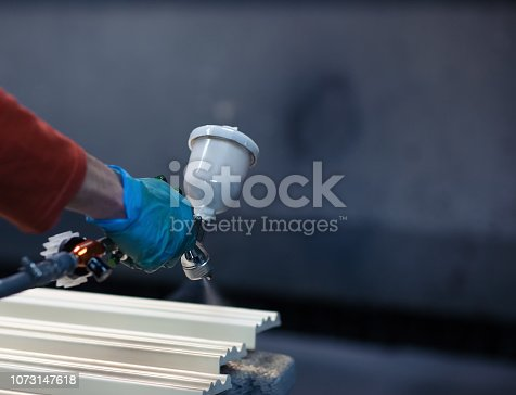 istock Painting wooden slats from an automatic spray 1073147618