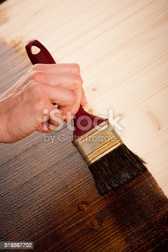 istock Painting wooden table for protection and wood maintenance oil-wax 519367702