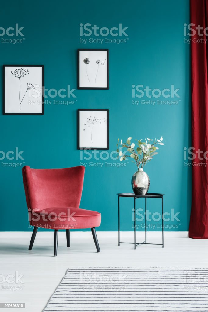 Paintings, armchair and table stock photo