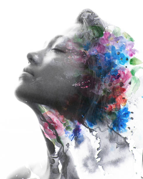 Paintography. Double exposure black and white profile portrait of a young natural beauty with closed eyes, relaxing and softly tilting her head back as her face and hair combine with hand drawn ink and watercolor painting with floral motifs stock photo