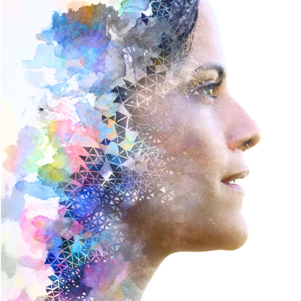Paintography. Double exposure. Close up of a strong attractive model combined with colorful hand drawn ink and watercolor paintings with overlapping triangular shapes and colors stock photo