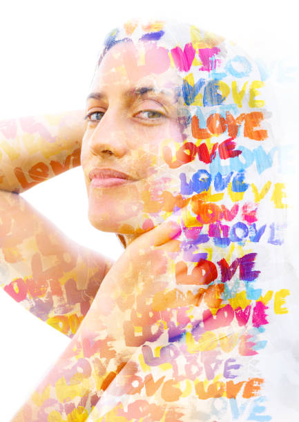 Paintography. Double exposure. Close up of a strong, attractive model combined with colorful hand drawn acryllic painting with overlapping brushstrokes repeating the word Love stock photo