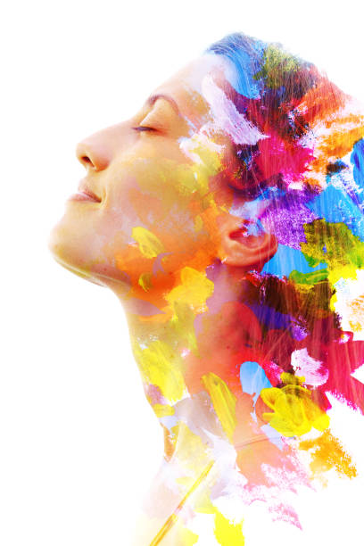 Paintography. Double exposure. Close up of a strong attractive model combined with colorful hand drawn acryllic paintings with overlapping brushstroke texture stock photo