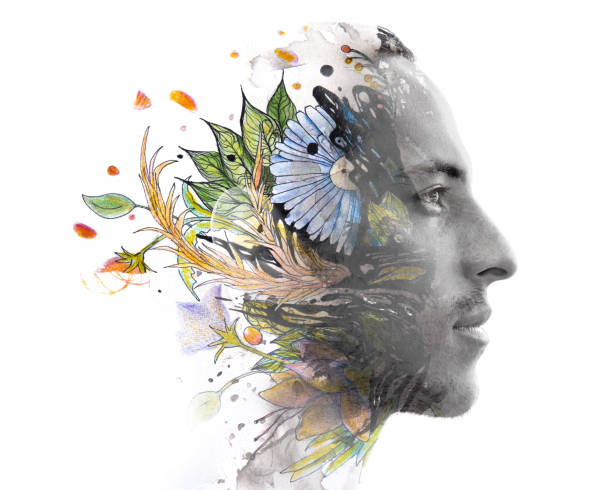 Paintography. Double exposure. Close up of man with strong features and flawless skin dissolving behind hand painted floral watercolor and pen painting stock photo