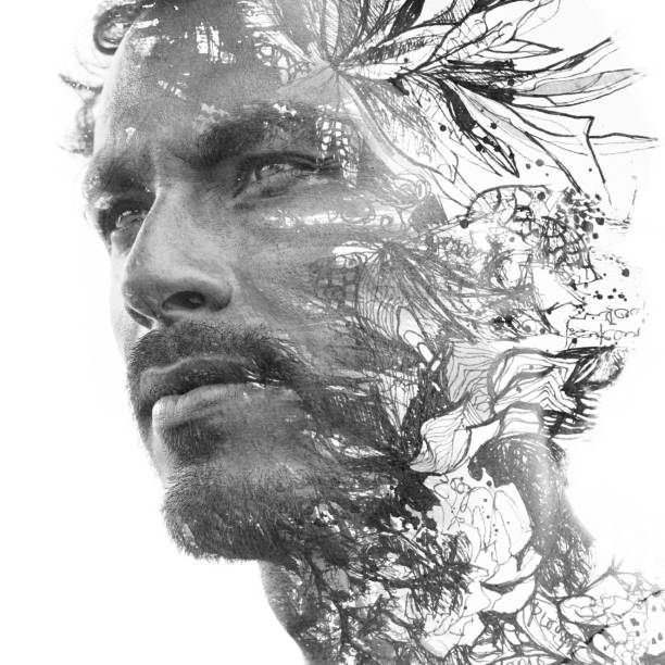 Paintography. Double exposure. Close up portrait of man with strong features and light beard dissolving behind hand painted floral watercolor and ink painting, black and white stock photo