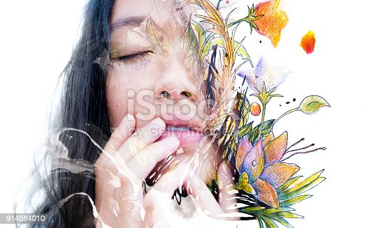 istock Paintography. Double exposure close-up of a sensual peaceful asian model gently touching her face combined with hand drawn ink and watercolour paintings with floral motifs 914584010