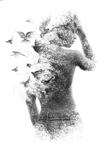 Paintography. Double exposure of a shirtless male model combined with handmade pen drawing of birds flying away and disintegrating, black and white stock photo