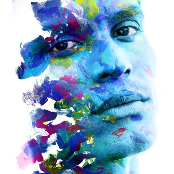 Paintography. Double exposure of an attractive male model combined with hand drawn ink paintings with depth and texture, colorful stock photo