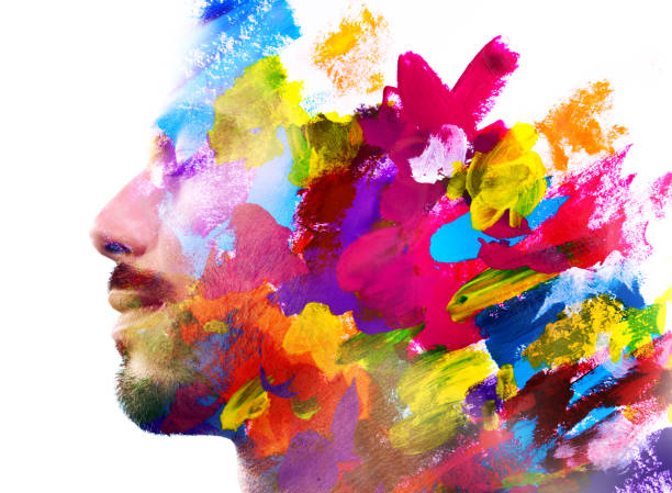 Paintography. Double exposure of an attractive male model combined with hand drawn ink paintings with colorful overlapping brushstroke texture stock photo