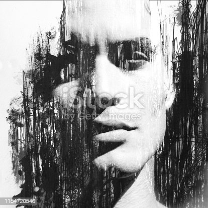 istock Paintography. Double exposure of an attractive male model combined with hand drawn ink pen drawings, black and white 1154720546