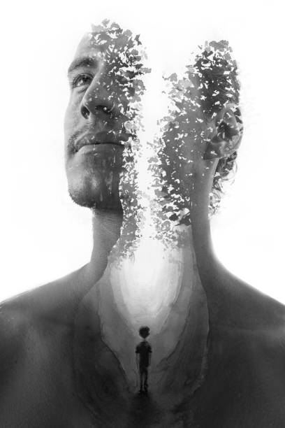 Paintography. Double exposure portrait combined with hand drawn painting of leaves and person's silhouette tells a mysterious story, black and white stock photo