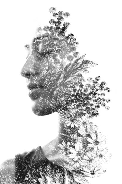 Paintography. Double Exposure portrait of a beautiful ethnic woman's profile combined with hand made drawing with floral motifs. black and white stock photo