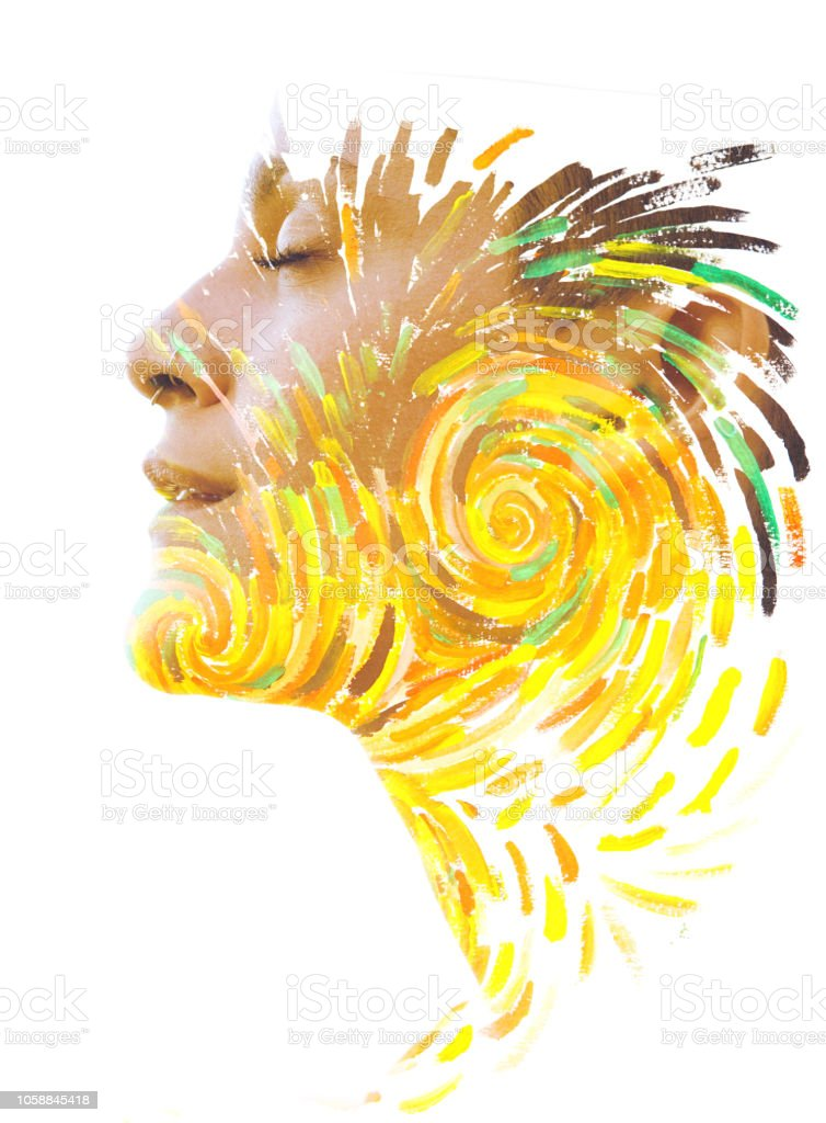 Paintography. Double exposure portrait of a beautiful peaceful woman combined with impressionistic style flowing brush strokes which explode with color and life stock photo