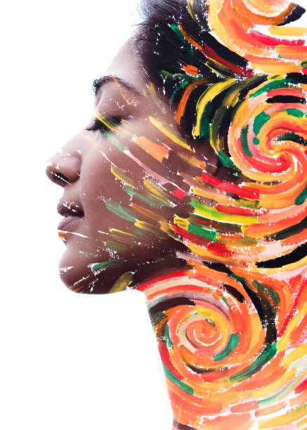 Paintography. Double exposure portrait of a beautiful pensive exotic woman combined with impressionistic style flowing brush strokes which explode with color and life stock photo