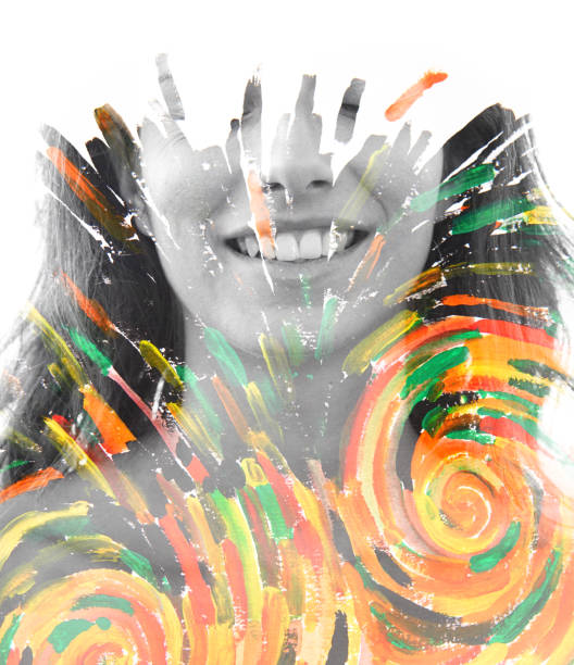 Paintography. Double exposure portrait of a healthy, happy woman combined with impressionistic style flowing brush strokes which explode with color and life stock photo