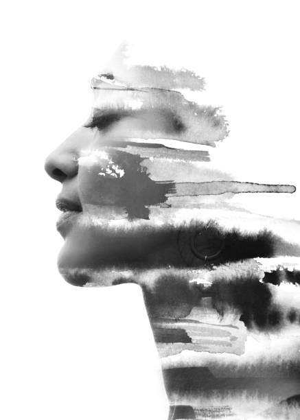 Paintography. Double Exposure portrait of a seductive ethnic woman's profile combined with hand drawn watercolor painting. black and white stock photo