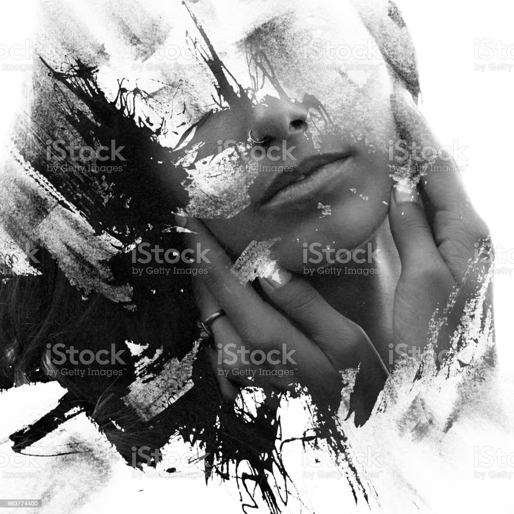 Paintography. Double Exposure portrait of a seductive ethnic woman's profile combined with hand drawn ink painting created using unique technique. black and white stock photo