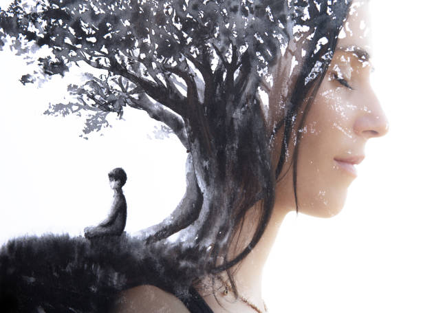Paintography. Double Exposure portrait of a serene woman with closed eyes combined with hand made painting of a person sitting under a tree stock photo