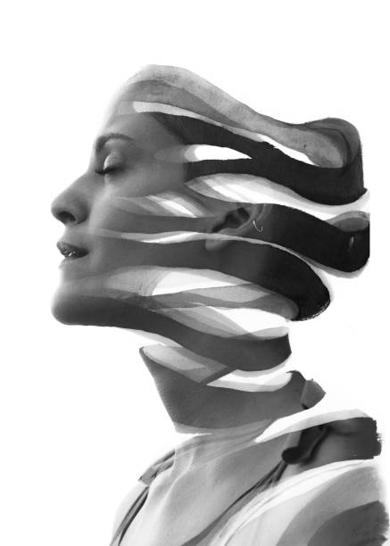 Paintography. Double Exposure portrait of a serene woman's profile combined with hand drawn ink painting, black and white stock photo