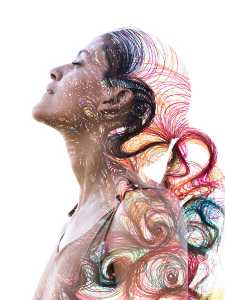 Paintography. Double exposure portrait of a young, beautiful, ethnic girl combined with hand drawn painting of intense colorful curved and wavy lines stock photo