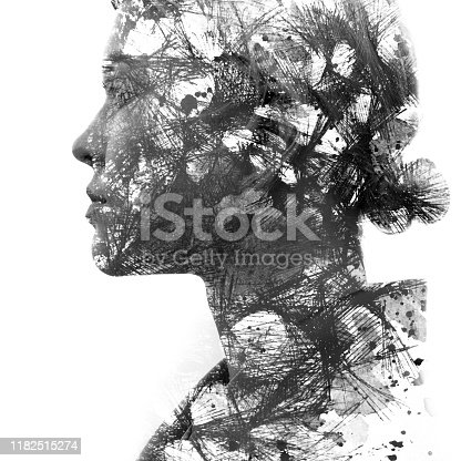 istock Paintography. Double exposure portrait of an attractive blonde woman combined with drawing of interconnecting lines dissolving into her face, on white background 1182515274