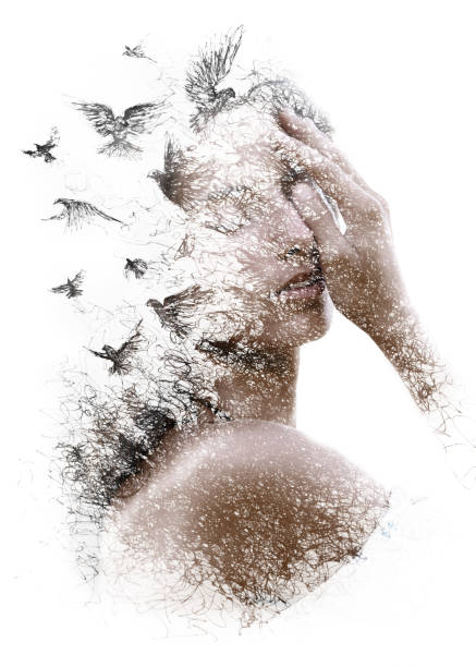 Paintography. Double Exposure portrait of an elegant woman with closed eyes combined with hand made pencil drawing of a flock of birds flying freely resembling disintegrating particles of her being stock photo