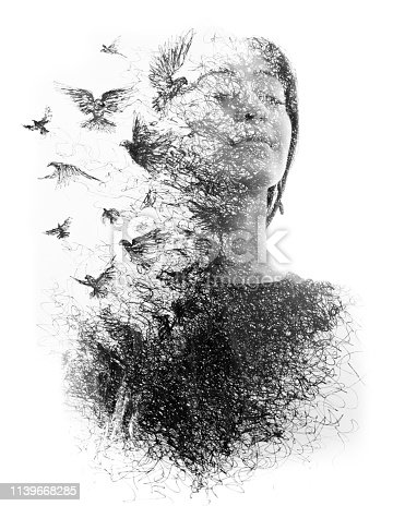 istock Paintography. Double Exposure portrait of an elegant woman with closed eyes combined with hand made pencil drawing of a flock of birds flying freely resembling disintegrating particles of her being, black and white 1139668285