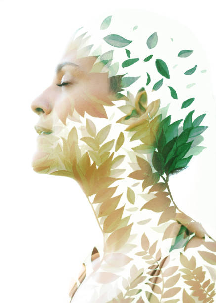 Paintography. Double Exposure portrait of an elegant woman's profile combined with hand drawn watercolor painting of leaves stock photo