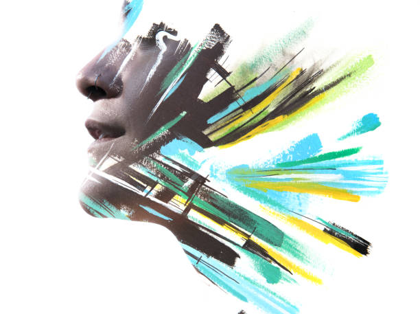 Paintography. Double exposure profile portrait of a strong, attractive female model with nose piercing combined with hand drawn blue, green and black brush strokes stock photo