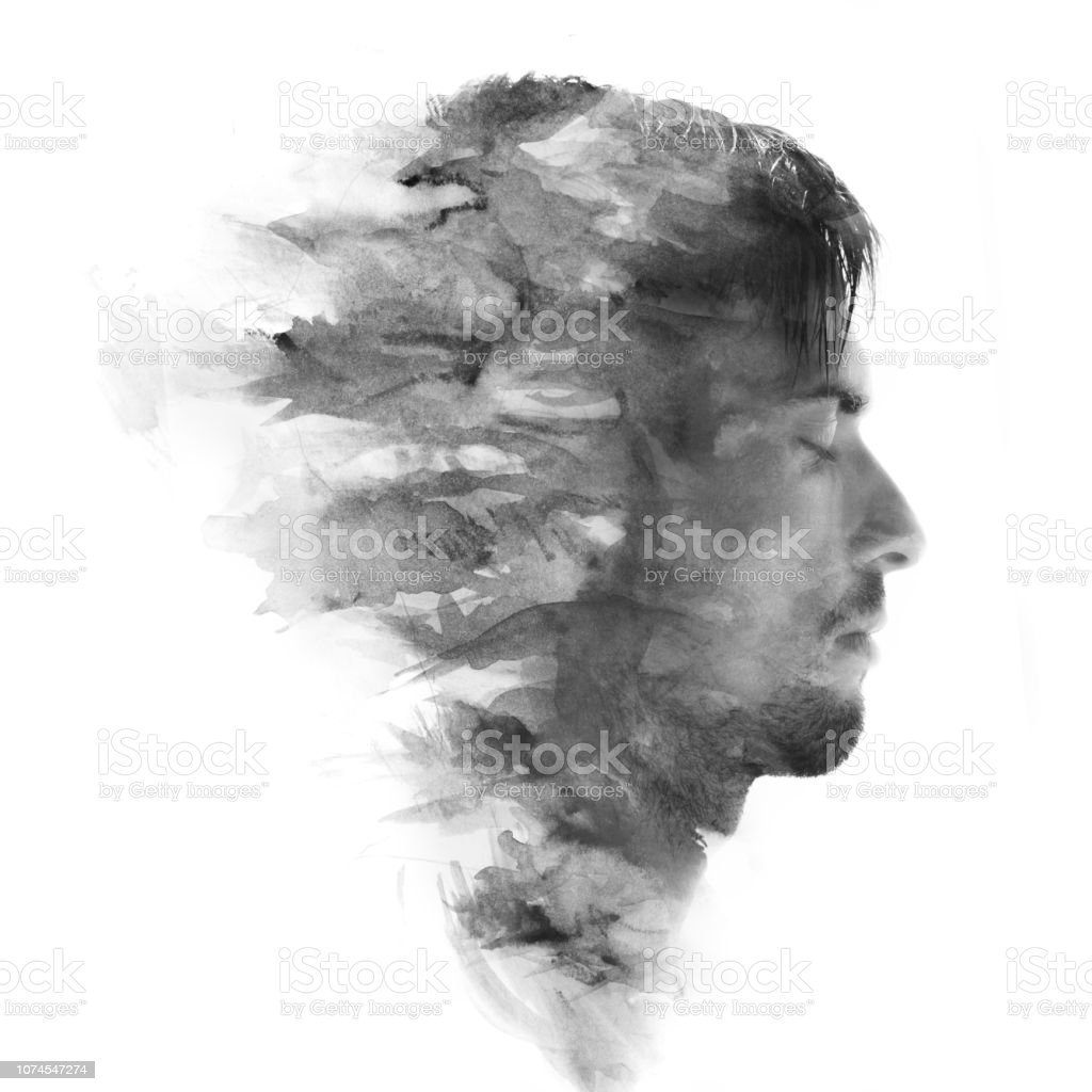Paintography. Double exposure profile portrait of a young, attractive man combined with black and white painting stock photo