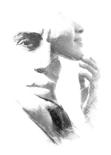 Paintography. Double exposure. Woman's profile portrait combined with hand drawn handsome man's face stock photo