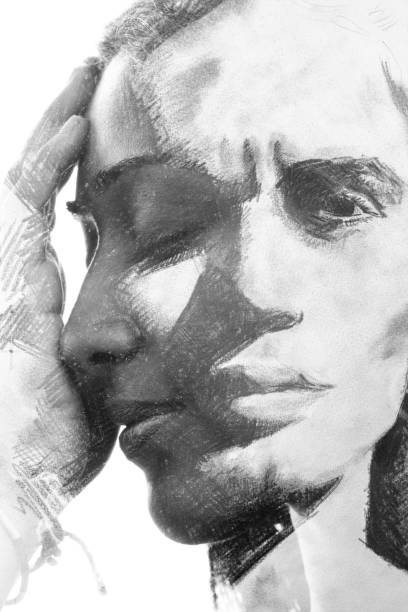 Paintography. Double exposure. Woman's profile portrait combined with hand made drawing of handsome man's face stock photo