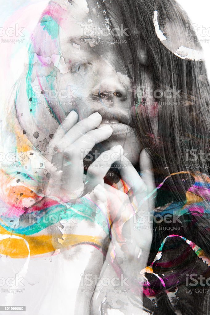 Paintography of a sensual peaceful model gently touching her face combined with hand drawn ink and watercolour paintings stock photo