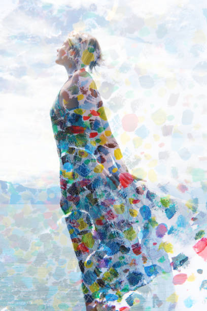 Paintography, photograph combined with painting, a free spirited girl with short hair wearing a summer dress enjoying the breeze stock photo